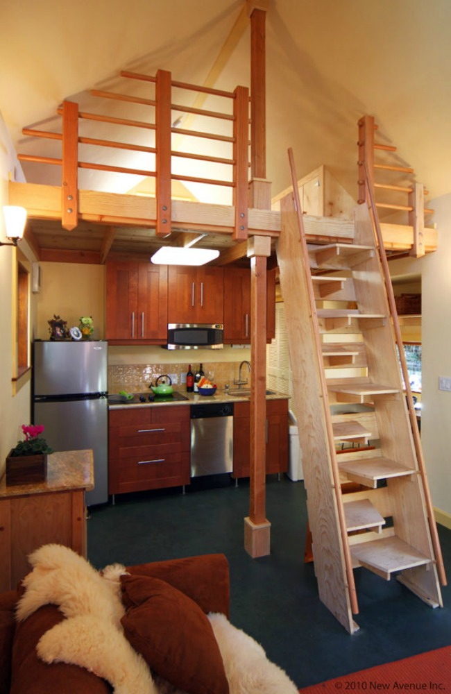 The living room and the stairs/ladder to the sleeping loft