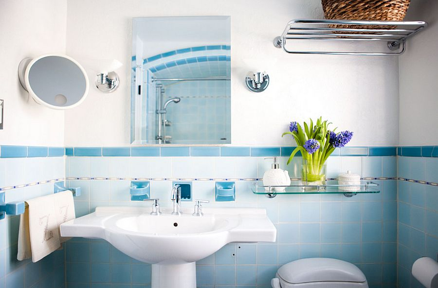 Lighting and wall tiles create a subtle ombre effect in the bathroom [Photography: Tess Fine]