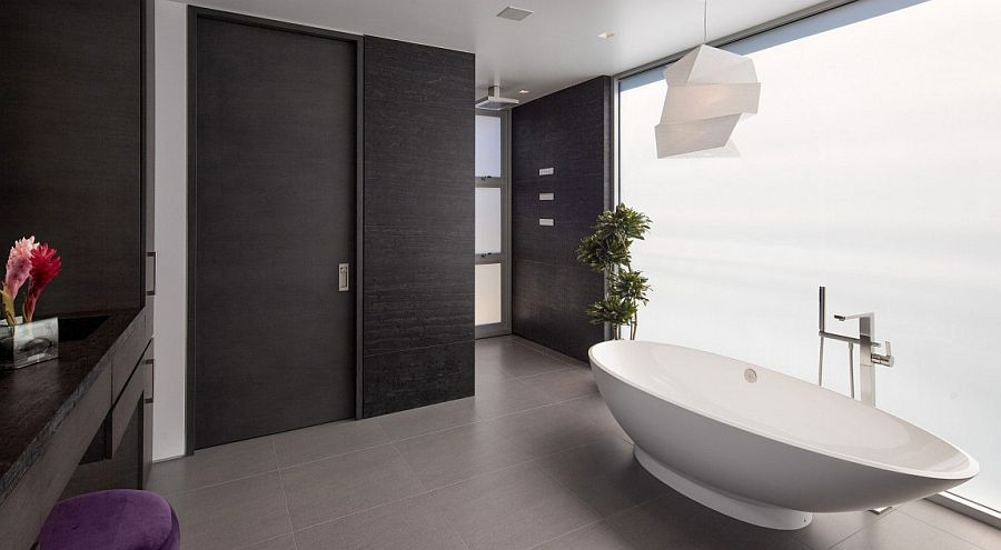 Lighting fixture, color palette and the potted plant give the master bathroom an oreintal appeal