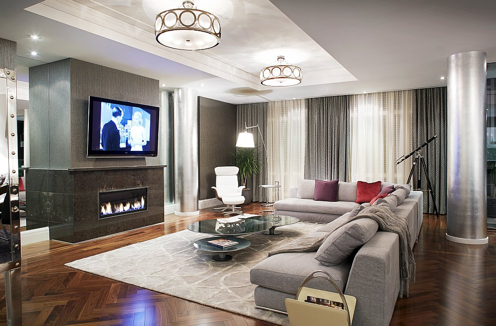 Living room with a cozy fireplace and iconic decor