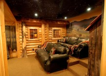 Log cabin style basement home theater with hand-painted murals and ceiling with fiber optics