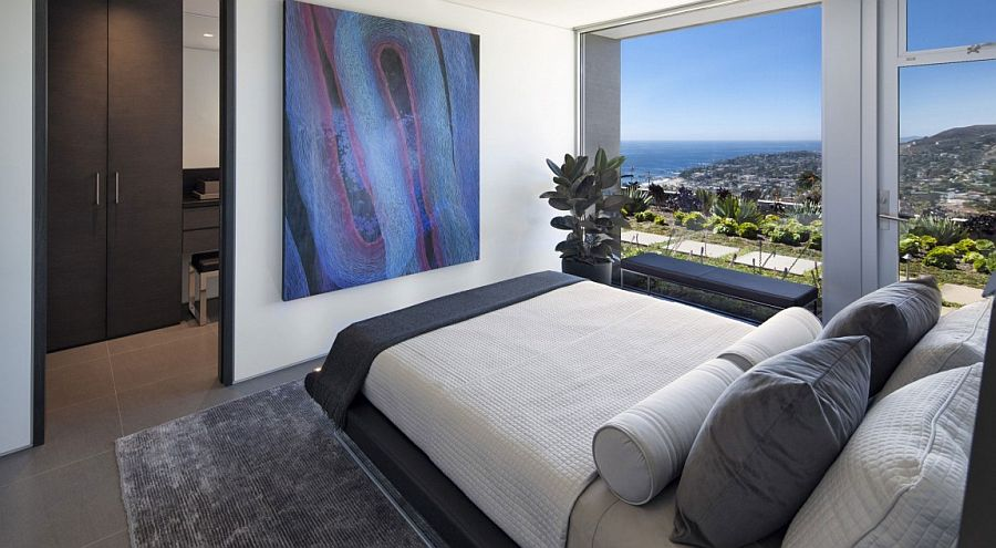 Lovely art work seems to complement the distant ocean making up the view!