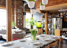 Lovely industrial dining room with a touch of green