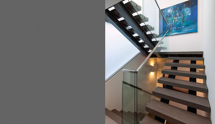 Lovely staircase connects various levels of the house and the garage
