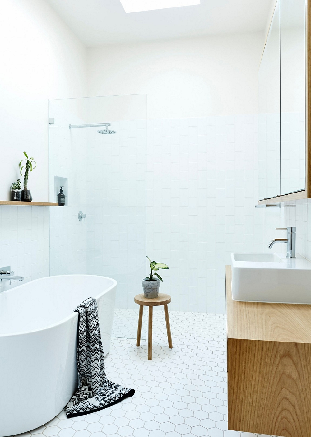 Luxurious bathroom in white with standalone bathtub