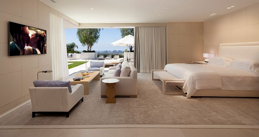 Luxurious contemporary bedroom that opens up towrads the private deck