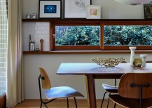 Narrow window in the dining room brings the garden charm indoors