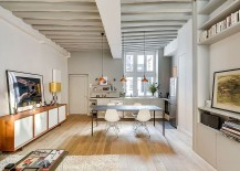 Open plan living area with dining space and kitchen 217x155 Small Apartment in Paris Gets a Chic, Space Conscious Makeover