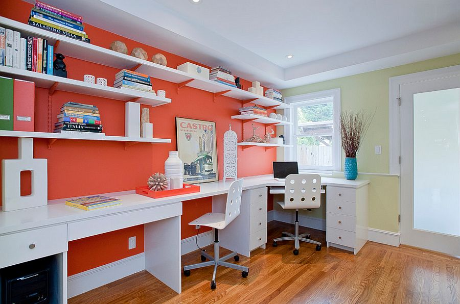 Open white shelves and desks add to the impact of orange in the home office [Design: Melissa Lenox Design]