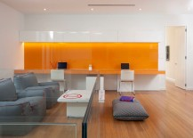 Orange backsplash and desk adds vibrant charm to the contemporary home office