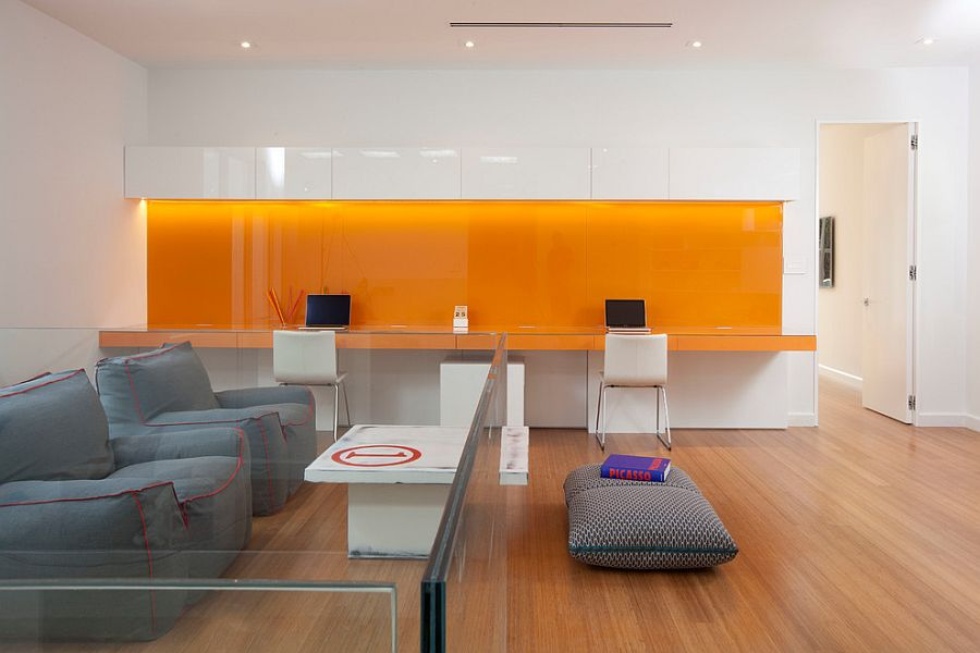 Orange backsplash and desk adds vibrant charm to the contemporary home office [Design: DKOR Interiors]