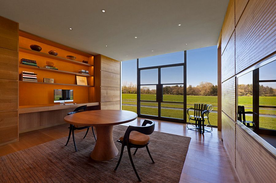 Orange in the room blends in with the warm wooden surfaces