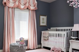 Pink additions in this gray nursey can be easily switched out
