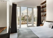 Plush-bedroom-with-private-balcony-and-view-of-the-rear-garden-217x155