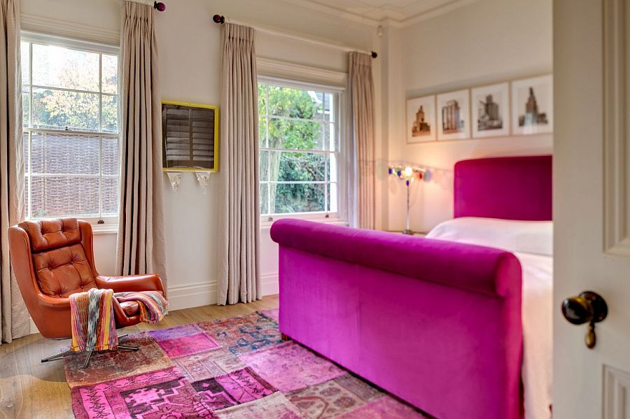 Plush decor and a splash of fuchsia in the master bedroom