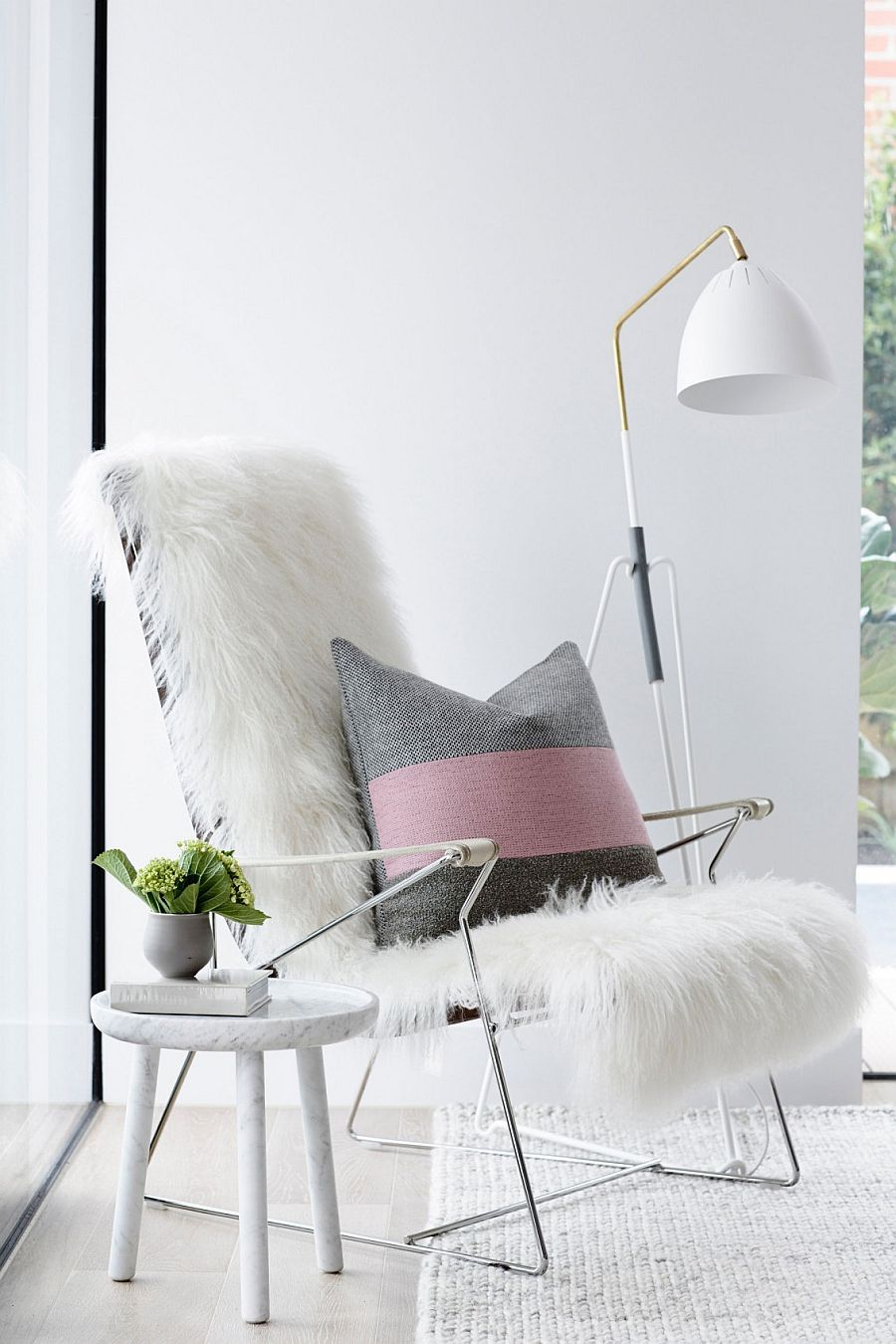 Plush decor and pinks add femininity to the space