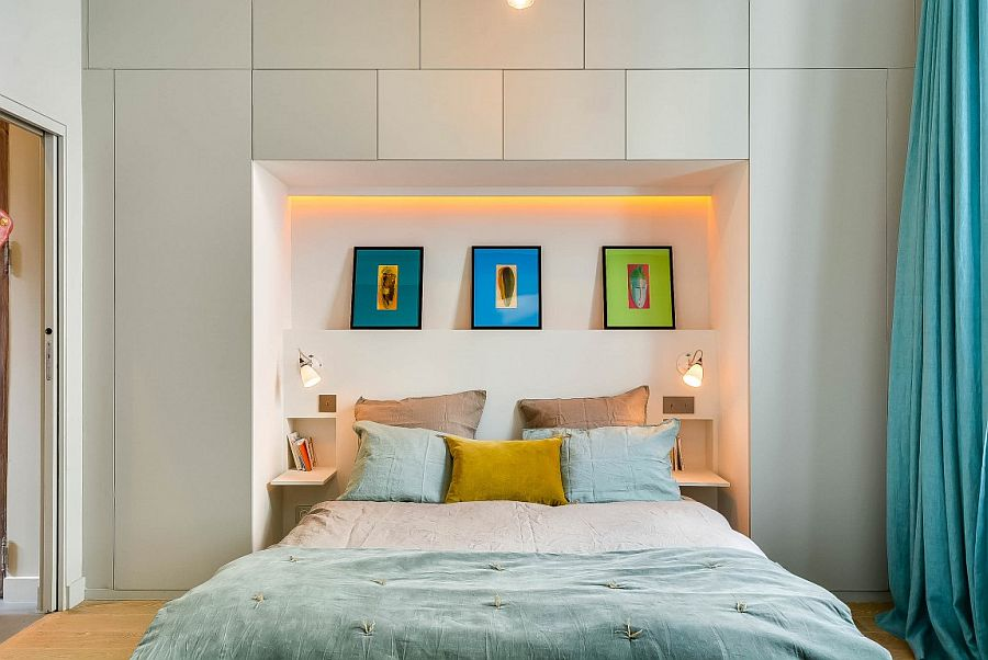 Recessed nook adds additional storage and display options to the small bedroom