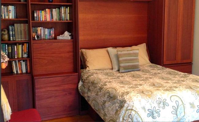 A wood-paneled cottage bedroom