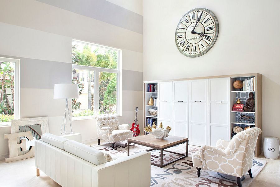 Serene living room with a cool accent wall [Design: Krista Watterworth Design Studio]