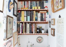 Shelves of the eclectic powder room are decked out with books