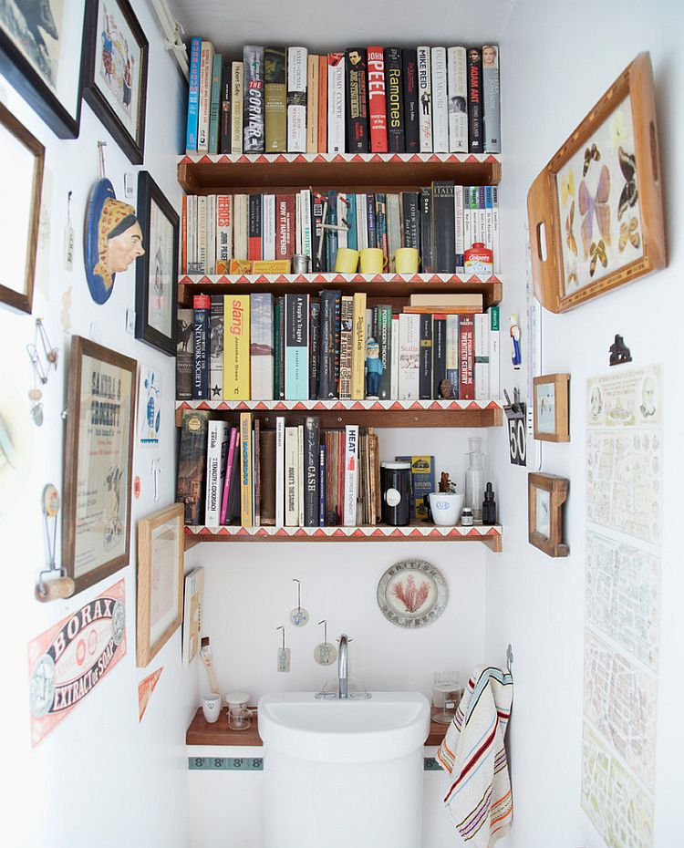 Shelves of the eclectic powder room are decked out with books [Design: Joanna Thornhill Interiors]