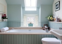 Skylight allows you to use color in the small bathroom with ease