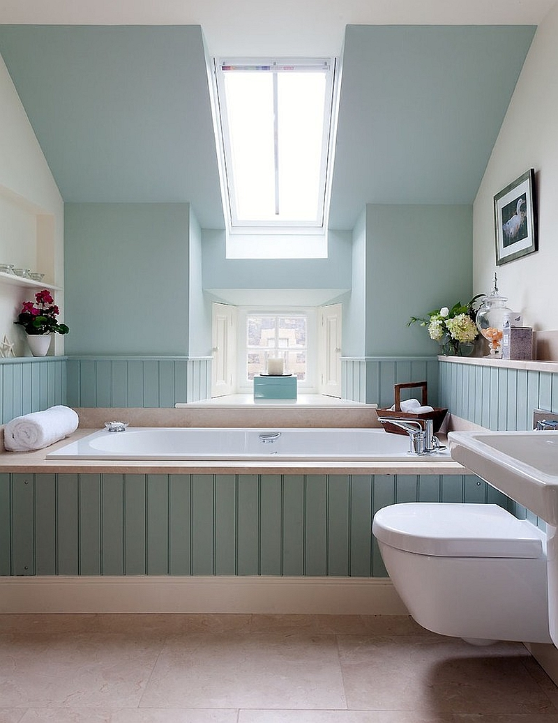 Skylight allows you to use color in the small bathroom with ease [Design: Robertson Lindsay Interiors]