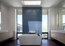 Skylight sheds the spotlight on the accent wall in the minimalist bathroom