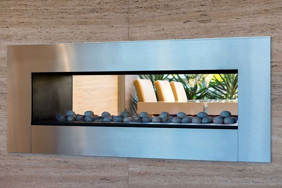Sleek contemporary fireplace serves both the living room and dining space