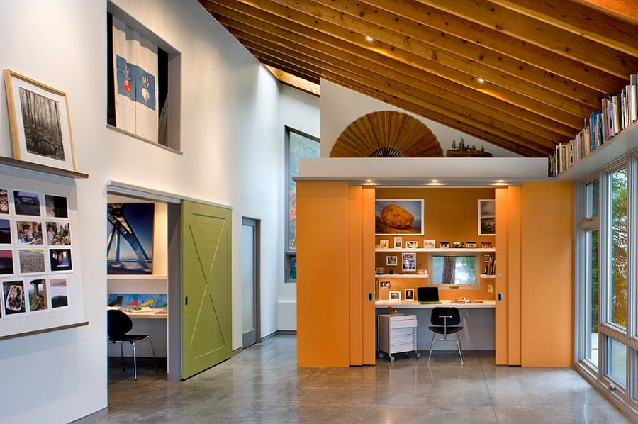 Sliding doors tuck away the home office when not in use