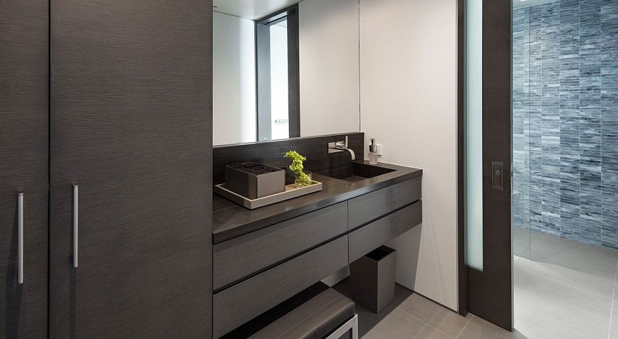 Sliding glass doors connect the bathroom with the bedroom