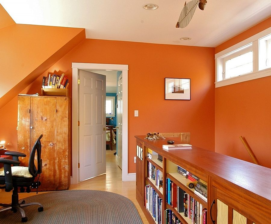 Small office in baked clay orange has a bright, cheerful appeal [Design: Joseph B Lanza Design + Building]