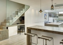 Small-workspace-under-the-stairs-with-ample-shelf-space-next-to-it-217x155