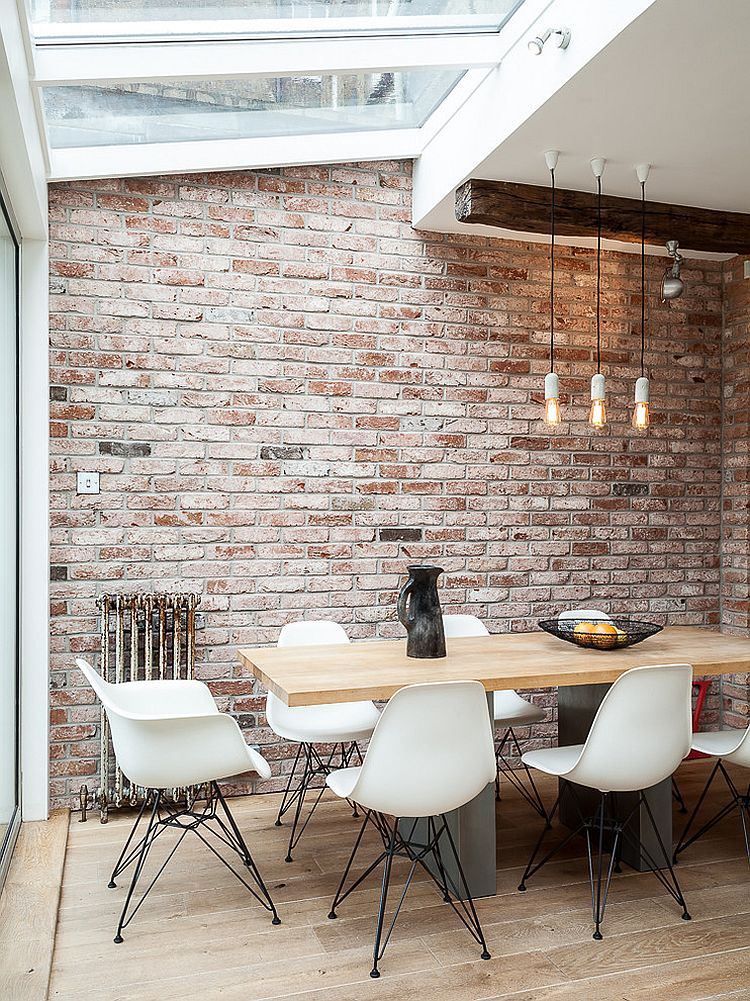 Smart industrial dining room of London home with skylights [Design: Stephanie Rackind Interiors / Simon Maxwell Photography]