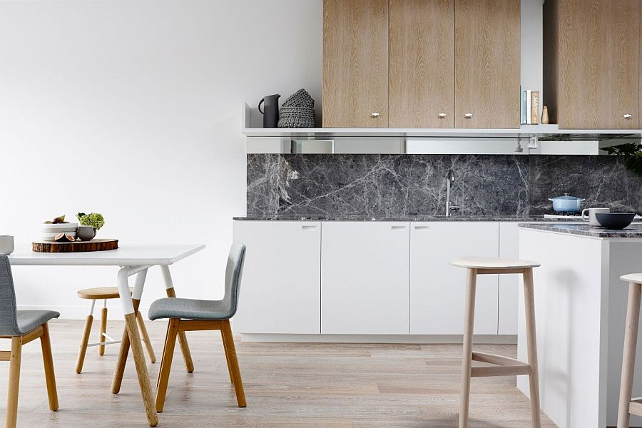 Smart kitchen backsplash adds a contrasting texture and hue to the kitchen