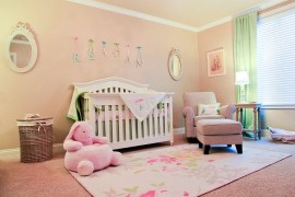 Soft peachy pink and green shape the nursery inspired by English countryside