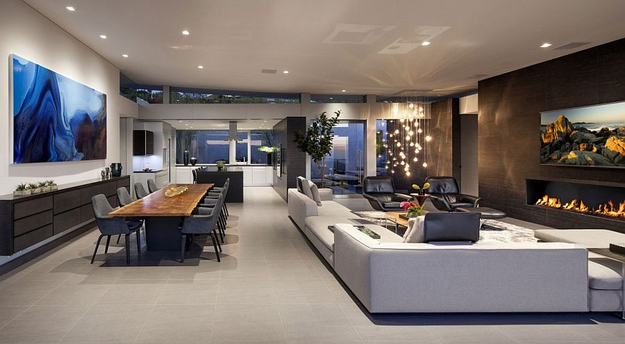 Sparkling cascading chandelier lights up the living area