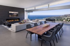 Stunning living area with terrace and view of the distant beach