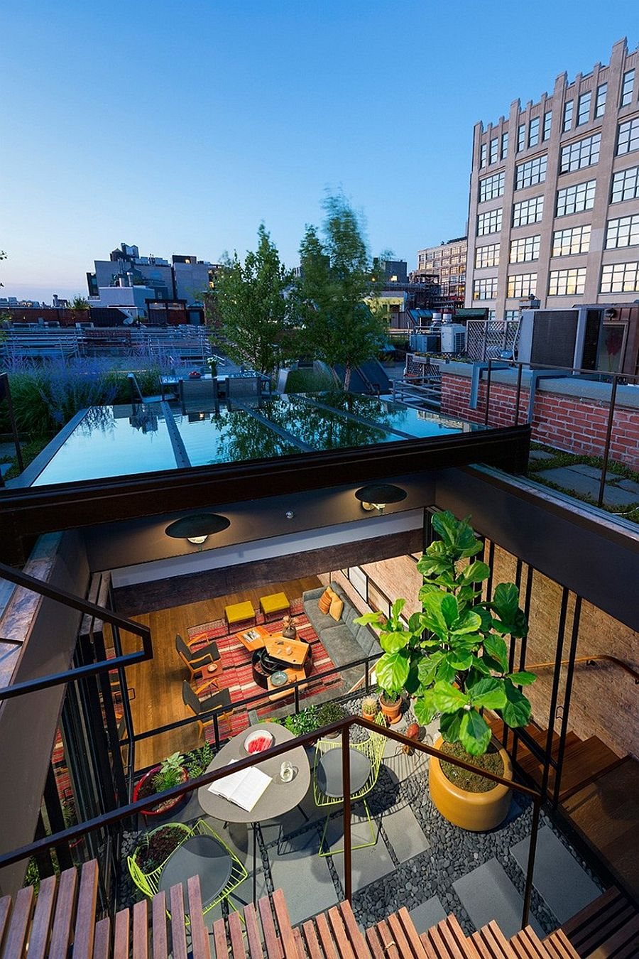 Sunken courtyard inside the transformed loft brings in ample light