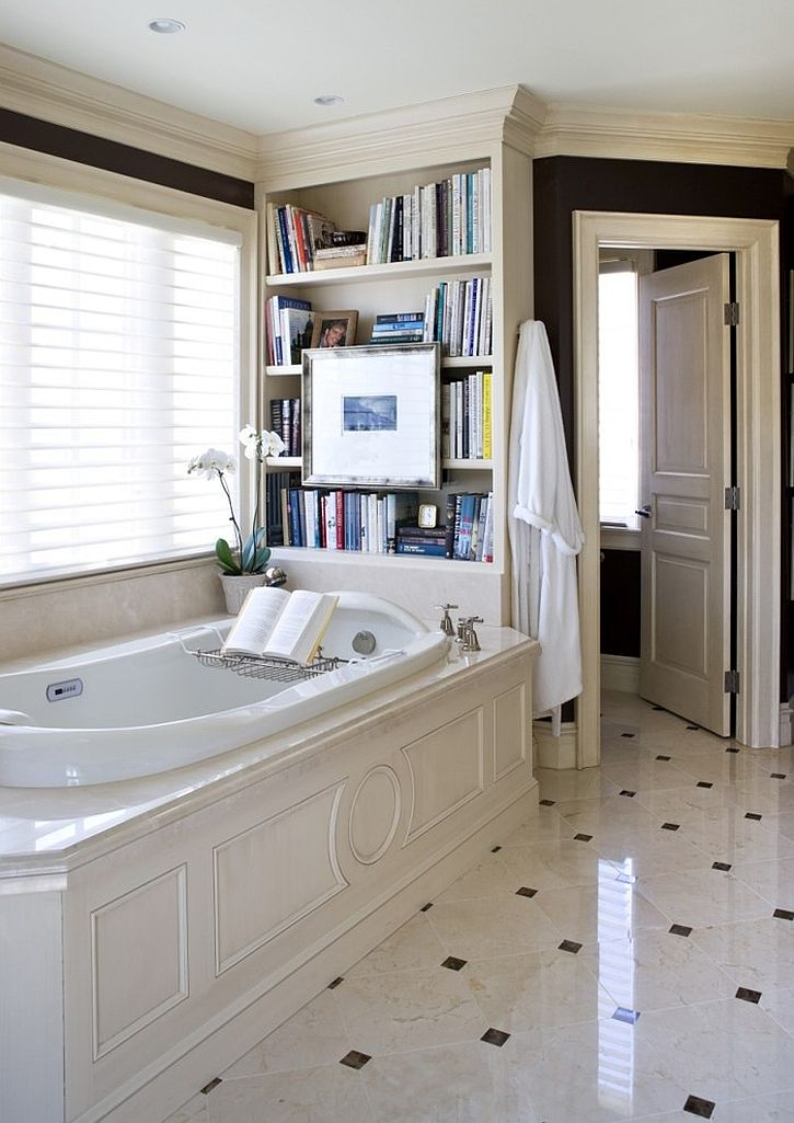 Traditional bathroom with a cheerful ambiance and a lovely bookshelf [Design: Sroka Design]