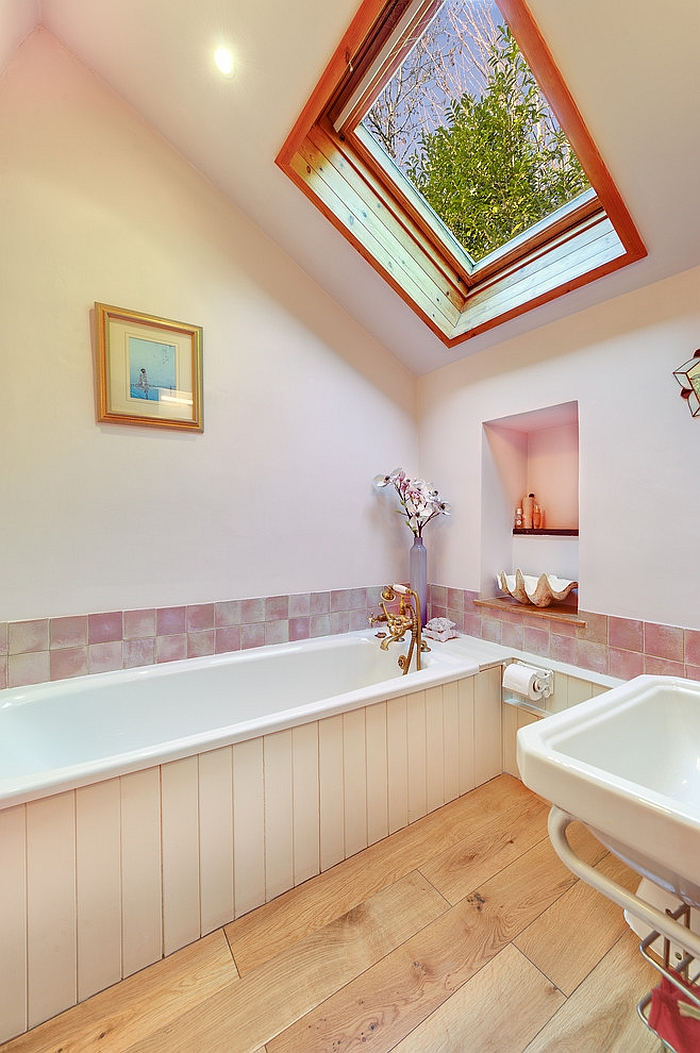 Tranquil farmhouse style bathroom with a skylight [From: Colin Cadle Photography]