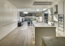 Trendy contemporary kitchen in white adds to the appeal of the revamped house