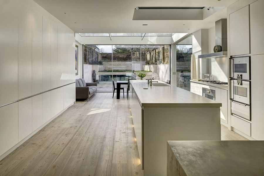 View In Gallery Trendy Contemporary Kitchen In White Adds To The Appeal Of  The Revamped House
