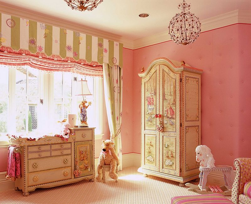 Tufted walls add elegance to the gorgeous nursery in pink [Design: Wendi Young Design]