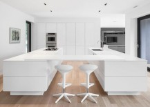 Twin kitchen workstations with a suspended breakfast bar