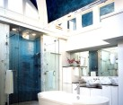 Unique Venetian ceiling design adds color and flair to the bathroom [Design: Inside Inc / Photography by Ira Montgomery]