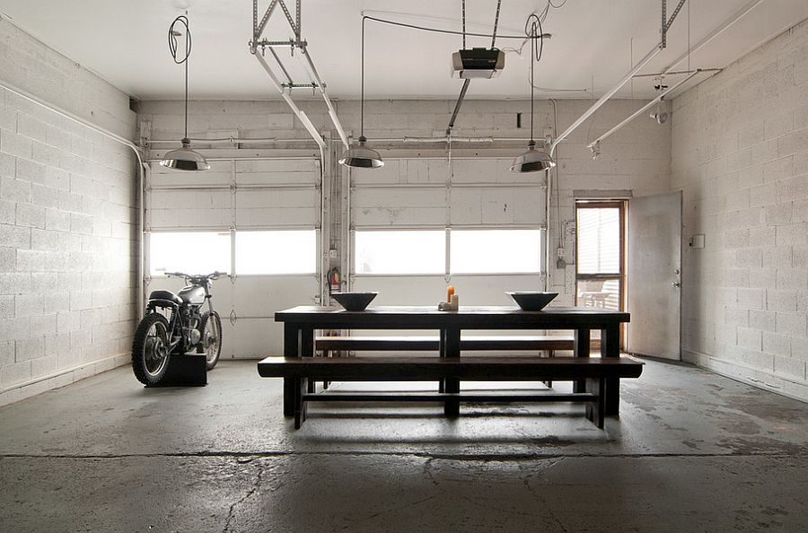 Unique industrial dining room with a bike! [Photography: Lucy Call]