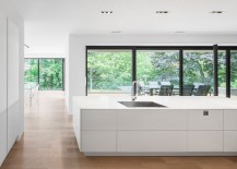 View of the lush greenery outside from the stylish kitchen
