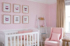 Vintage framed pictures and a ladder shelf in the lovely nursery