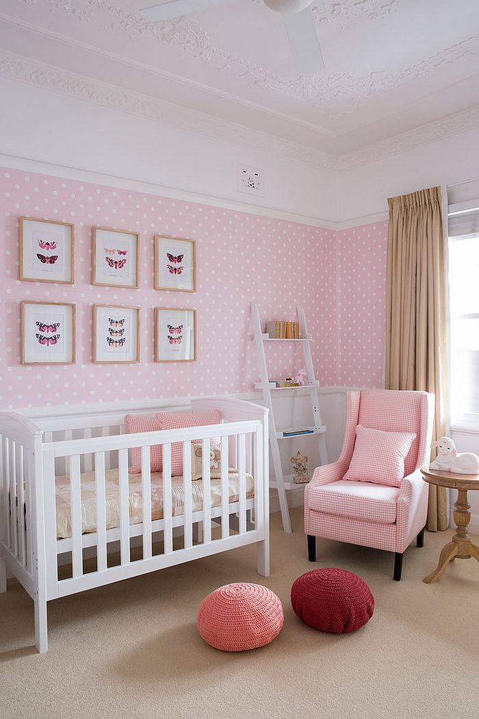 Vintage framed pictures and a ladder shelf in the lovely nursery [Design: Horton & Co. Designers]